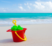 bucket and toys on the beach