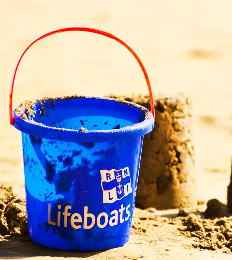 bucket at the beach and sand