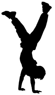 silhouette of boy doing handstand