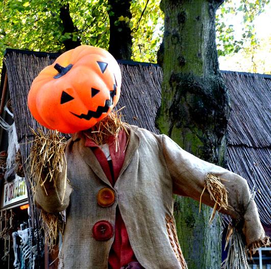 Smiling pumpkin man made of straw