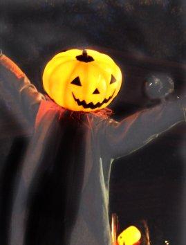 lighted pumpkin man at night