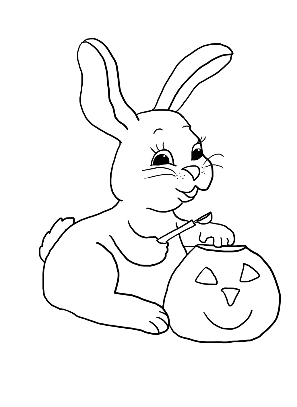 halloween bunny carving a pumpkin head