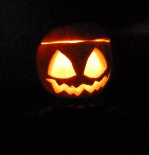 Halloween pumpkin head with light