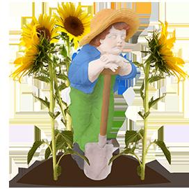 garden child statue with sunflowers