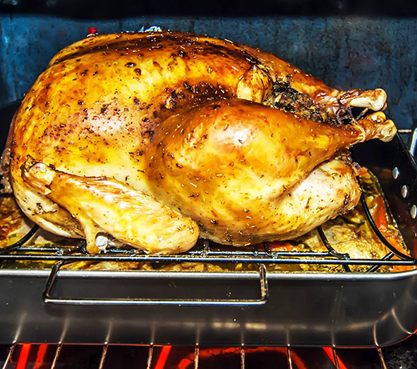 delicious Thanksgiving turkey in oven
