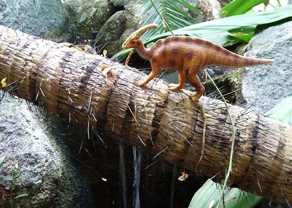 Dinosaur passing water fall