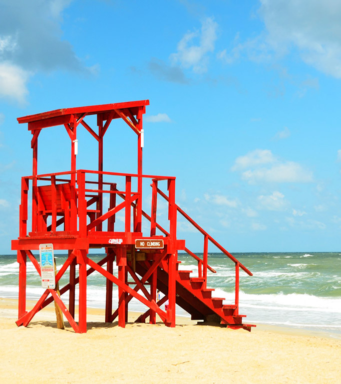 empty life guard stand beach