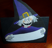 Place card for Halloween witch with sign