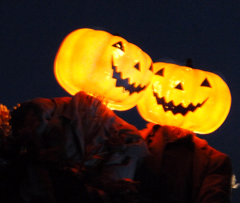 lighted heads of scary pumpkin men