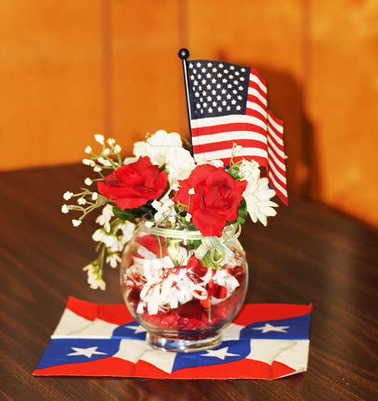 patriotic flower and flag arrangement