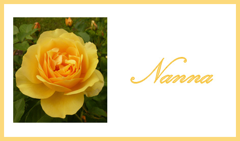 place card with orange rose and name