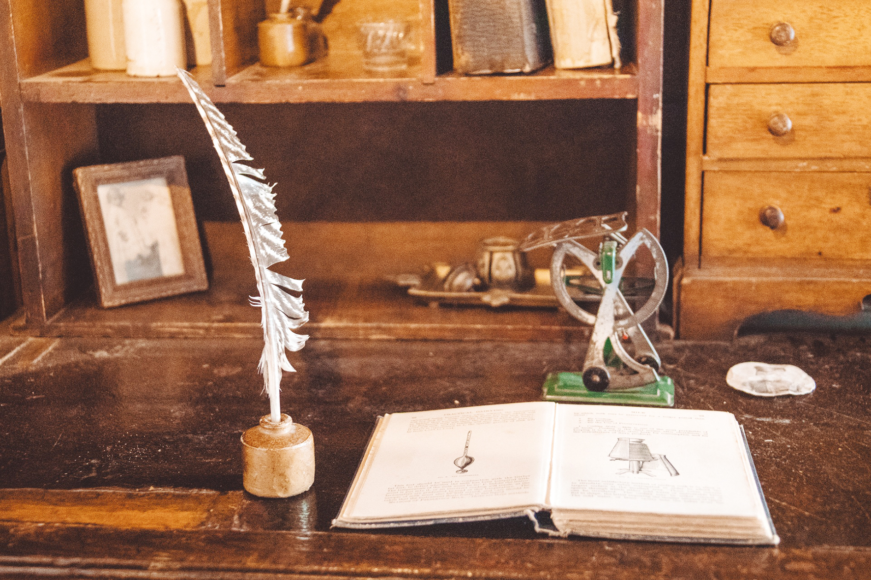 quill and an old book background
