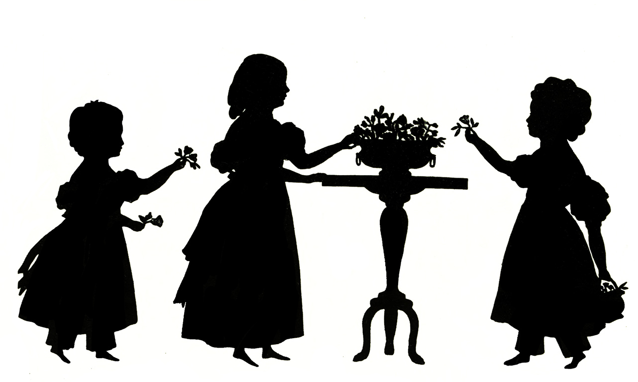 three little victorian girls with flowers