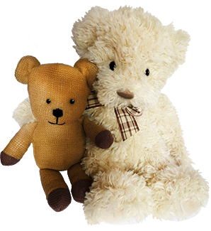 white and brown vintage Teddy bear together