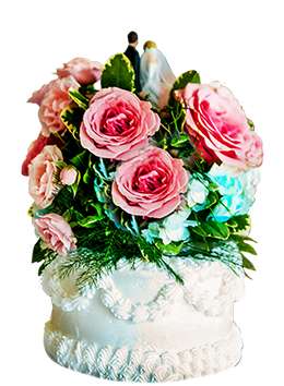 wedding cake with bride and groom and flowers